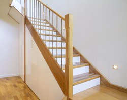 European Oak staircase with white risers in a contemporary architect designed home