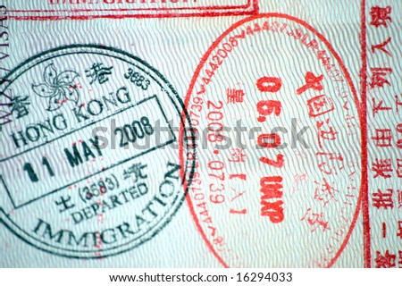 European passport full of stamps from China and Hongkong borders.