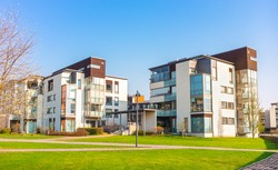 European residential complex of apartment buildings. Outdoor facilities. Eco-friendly living in city. Modern block of flats. Scandinavian architecture. Courtyard, green lawn Lifestyle Helsinki Finland