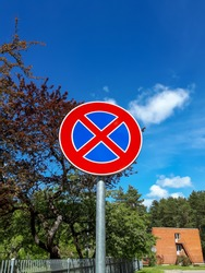 European road sign (A red cross over a blue background)