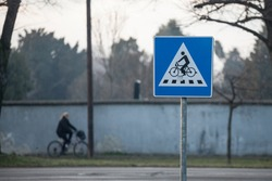 European roadsign indicating the presence of a bicycle crossing to cars. Bike xing is a major safety issue on road, especially when a motor street crosses a bicycle lane.