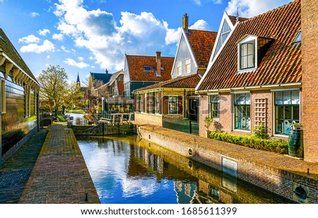 European spring city river canal. River canal in town. Spring river canal in european town. Town river canal