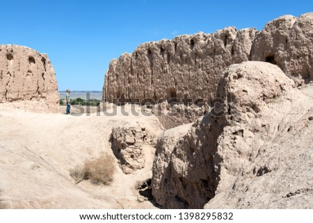 European tourist in Kyzyl Kala fortress, one of the most popular touristic destination in the country. Karakalpakstan, Uzbekistan, Central Asia.