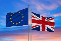 European Union and British Union Jack flag flying in front of bright blue sky in a backlit statement of the Brexit EU referendum