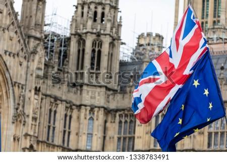 European Union and British Union Jack flag flying together.  #1338783491