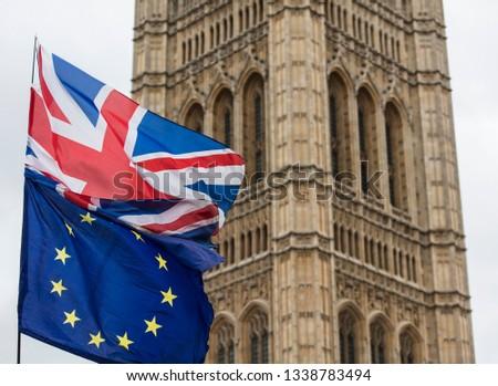 European Union and British Union Jack flag flying together.  #1338783494