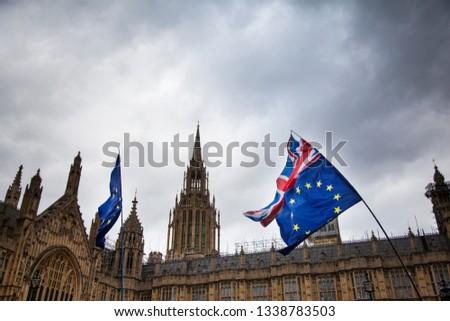 European Union and British Union Jack flag flying together.  #1338783503