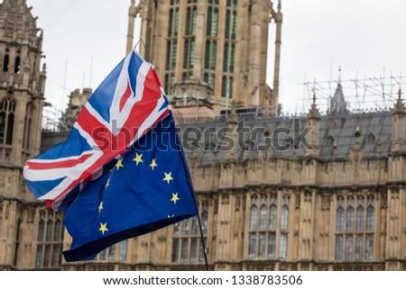 European Union and British Union Jack flag flying together.  #1338783506