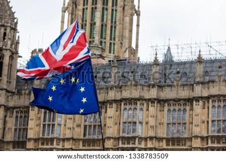 European Union and British Union Jack flag flying together.  #1338783509