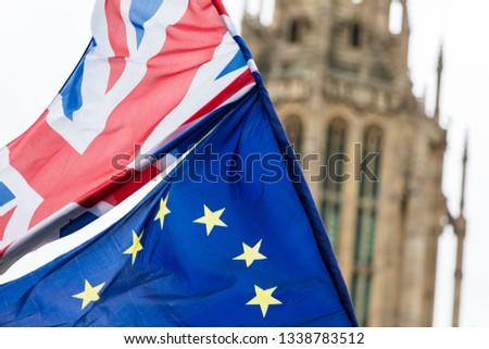 European Union and British Union Jack flag flying together.  #1338783512