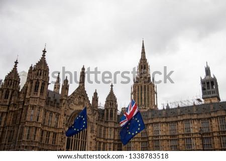 European Union and British Union Jack flag flying together.  #1338783518