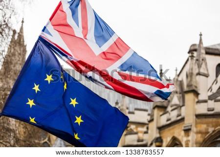 European Union and British Union Jack flag flying together.  #1338783557