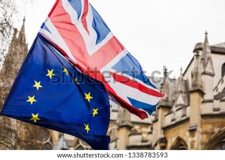 European Union and British Union Jack flag flying together.  #1338783593