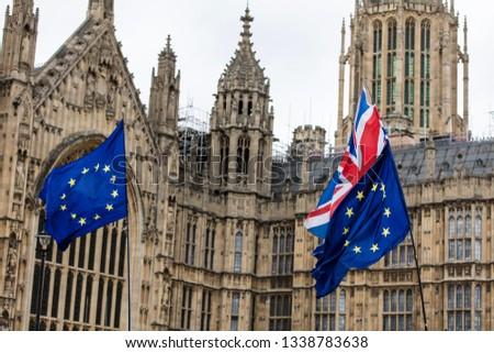 European Union and British Union Jack flag flying together.  #1338783638