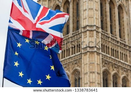 European Union and British Union Jack flag flying together.  #1338783641