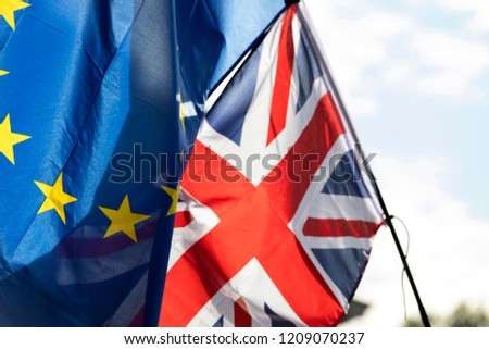 European union and British Union jack flags flying together. Brexit concept #1209070237