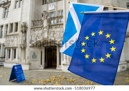 European Union and Scottish flags flying in front of The Supreme Court of the United Kingdom in the public Middlesex Guildhall building in Parliament Square in London