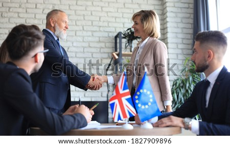European Union and United Kingdom leaders shaking hands on a deal agreement. Brexit. Сток-фото ©