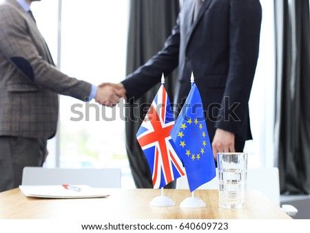 European Union and United Kingdom leaders shaking hands on a deal agreement. Brexit Сток-фото ©