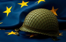 European union army, military uniform and defense of Europe concept with soldier helmet with camouflage pattern and the EU flag in the background