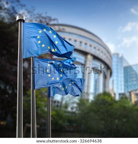 European union flag against parliament in Brussels, Belgium #326694638