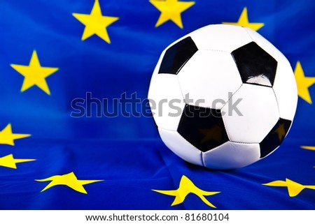 european union flag and soccer ball - stock photo