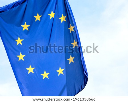 European Union flag, EU symbol part up close, 12 stars flag object detail, closeup, clear sky in the background, nobody. Politics, economy, business and EU, Europe culture, laws abstract concept ストックフォト ©