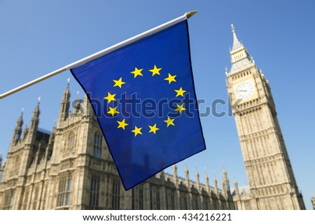 European Union flag fluttering in front of Big Ben and the Houses of Parliament at Westminster Palace, London, in preparation for the Brexit EU referendum