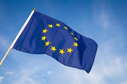 European Union flag flying in front of bright blue sky
