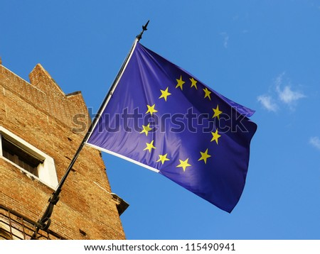 European Union flag in a sunny day on blue and clean sky. Emblem of EU and Council of Europe.