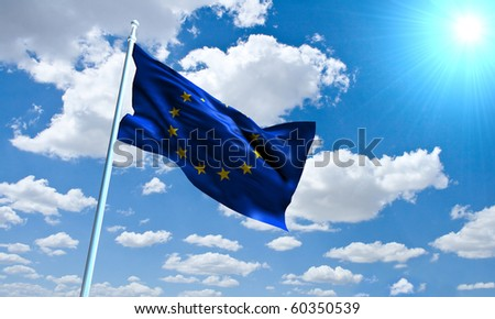European Union Flag in front of vivid, sunny, cloudy sky