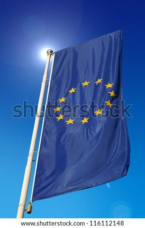 European Union Flag / Vertical European Union flag, waving in the blue sky