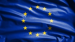 European Union flag waving in the wind. Close up of Europe banner blowing, soft and smooth silk. Cloth fabric texture ensign background. Use it for national day and country occasions concept.