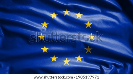 European Union flag waving in the wind. Close up of Europe banner blowing, soft and smooth silk. Cloth fabric texture ensign background. Use it for national day and country occasions concept. Photo stock ©