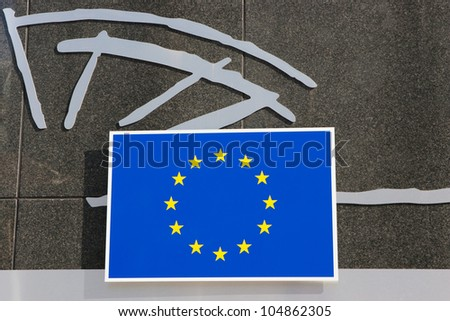 European Union logotype next to the Council of the European Union Building in Brussels