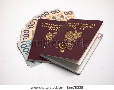 European Union passport and polish money isolated on white