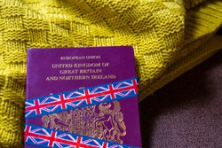 European Union United Kingdom of Great Britain and Northern Ireland burgundy passport on isolated  background. Brexit, no access, leaving EU, no deal, British government, union jack, Halloween concept