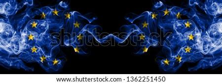 European Union vs European Union, EU smoke flags placed side by side. Thick colored silky smoke flags of EU and European Union, EU