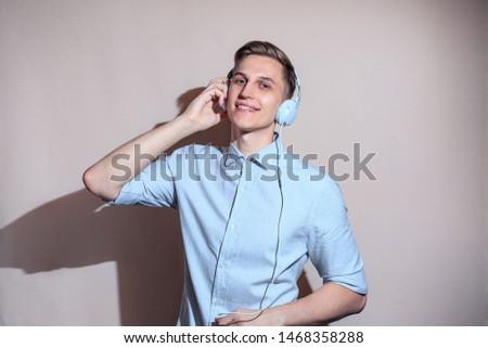 European white guy with headphones