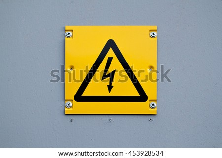 European yellow lightning sign of high voltage. Warning about dangerous electricity. #453928534