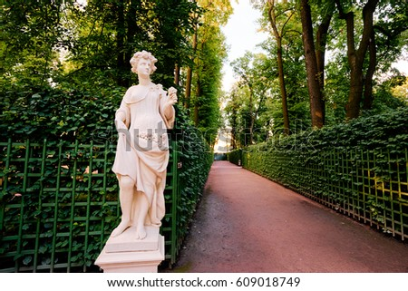 Shutterstock Euterpe - muse of lyric poetry and music. Green alley on the park alley Summer Garden in St. Petersburg