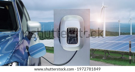 EV Car or electric power car and solar cells for electricity generation,plug of power cable electric supply during charging at ev car.