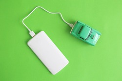 EV or electric car charging with power bank minimal creative concept.