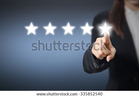 evaluation concept. Businesswoman pointing five star to increase rating of company, Increase rating.