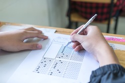 Evaluation or measurement concept. Student testing in exercise taking fill in exam at school or university in test room, writing document exams paper at campus classroom, education back to school idea