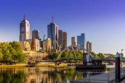 Evan Walker pedestrian bridge across Yarra River with Melbourne CBD panorama in the backdrop. The architecture of Melbourne, Victoria, Australia. High Resolution Photography.