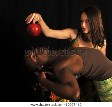 Eve tempting Adam with and apple on a black background in the garden of eden.