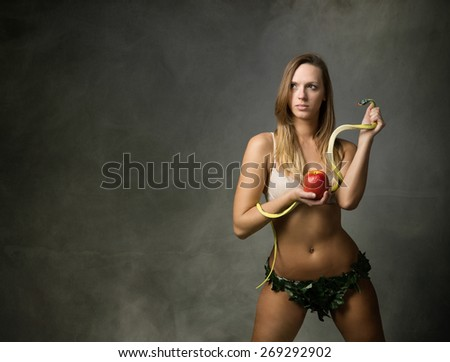 eve with snake and apple, dark and foggy room
