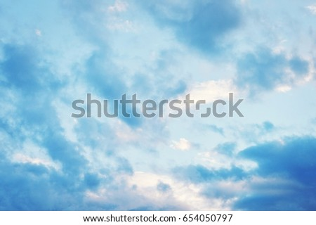 Evening blue sky with clouds. Beautiful summer sunset. Stock photo for design web site and posters
