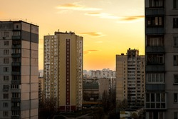 evening city landscape with high-rise buildings on the background of the sunset sky.